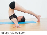 Купить «Fit woman doing the plough posture in fitness studio», фото № 30024994, снято 24 июля 2013 г. (c) Wavebreak Media / Фотобанк Лори