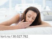 Купить «Woman yawning with eyes closed in bed», фото № 30027782, снято 7 августа 2013 г. (c) Wavebreak Media / Фотобанк Лори