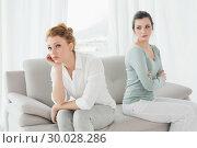 Купить «Unhappy friends not talking after argument on the couch», фото № 30028286, снято 16 августа 2013 г. (c) Wavebreak Media / Фотобанк Лори