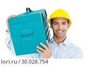 Купить «Smiling handyman in hard hat carrying a toolbox», фото № 30028754, снято 8 августа 2013 г. (c) Wavebreak Media / Фотобанк Лори