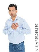 Купить «Portrait of a casual young man with chest pain», фото № 30028810, снято 8 августа 2013 г. (c) Wavebreak Media / Фотобанк Лори