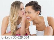 Купить «Closeup of female friends with coffee cup gossiping», фото № 30029054, снято 13 августа 2013 г. (c) Wavebreak Media / Фотобанк Лори