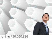 Купить «Composite image of serious asian businessman », фото № 30030886, снято 1 ноября 2013 г. (c) Wavebreak Media / Фотобанк Лори