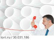 Купить «Composite image of businessman screaming directly into the handset », фото № 30031186, снято 1 ноября 2013 г. (c) Wavebreak Media / Фотобанк Лори