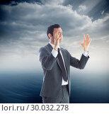 Купить «Composite image of unsmiling businessman with arms raised», фото № 30032278, снято 2 ноября 2013 г. (c) Wavebreak Media / Фотобанк Лори