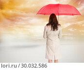Купить «Composite image of businesswoman standing back to camera holding red umbrella», фото № 30032586, снято 2 ноября 2013 г. (c) Wavebreak Media / Фотобанк Лори