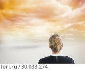 Купить «Composite image of businesswoman standing with hands on hips», фото № 30033274, снято 2 ноября 2013 г. (c) Wavebreak Media / Фотобанк Лори