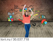 Composite image of laughing teenage wearing casual clothes while raising her arms. Стоковое фото, агентство Wavebreak Media / Фотобанк Лори