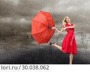 Купить «Composite image of elegant blonde holding umbrella», фото № 30038062, снято 10 ноября 2013 г. (c) Wavebreak Media / Фотобанк Лори
