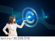 Composite image of smiling businesswoman raising her hand. Стоковое фото, агентство Wavebreak Media / Фотобанк Лори