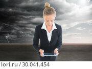 Купить «Composite image of businesswoman holding new tablet», фото № 30041454, снято 10 ноября 2013 г. (c) Wavebreak Media / Фотобанк Лори