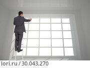 Купить «Composite image of businessman standing on ladder», фото № 30043270, снято 11 ноября 2013 г. (c) Wavebreak Media / Фотобанк Лори