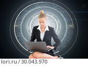 Купить «Composite image of businesswoman using laptop», фото № 30043970, снято 11 ноября 2013 г. (c) Wavebreak Media / Фотобанк Лори
