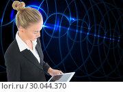 Купить «Composite image of businesswoman holding tablet», фото № 30044370, снято 11 ноября 2013 г. (c) Wavebreak Media / Фотобанк Лори