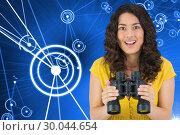 Купить «Composite image of smiling casual young woman holding binoculars», фото № 30044654, снято 11 ноября 2013 г. (c) Wavebreak Media / Фотобанк Лори