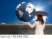 Купить «Composite image of elegant businesswoman holding black umbrella», фото № 30044762, снято 11 ноября 2013 г. (c) Wavebreak Media / Фотобанк Лори
