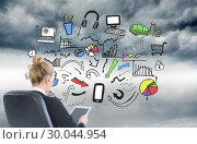 Купить «Composite image of businesswoman sitting on swivel chair with tablet», фото № 30044954, снято 11 ноября 2013 г. (c) Wavebreak Media / Фотобанк Лори