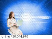 Купить «Composite image of smiling businesswoman sitting and using laptop», фото № 30044970, снято 11 ноября 2013 г. (c) Wavebreak Media / Фотобанк Лори