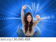 Купить «Composite image of woman looks straight ahead as she celebrates in front of her laptop», фото № 30045458, снято 11 ноября 2013 г. (c) Wavebreak Media / Фотобанк Лори