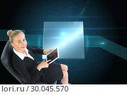 Купить «Composite image of businesswoman sitting on swivel chair with tablet», фото № 30045570, снято 11 ноября 2013 г. (c) Wavebreak Media / Фотобанк Лори