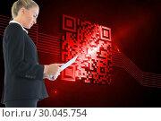 Composite image of businesswoman holding tablet. Стоковое фото, агентство Wavebreak Media / Фотобанк Лори