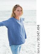 Купить «Casual woman with arms outstretched at beach», фото № 30047494, снято 10 октября 2013 г. (c) Wavebreak Media / Фотобанк Лори