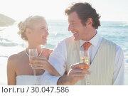Купить «Young newlyweds having champagne linking arms», фото № 30047586, снято 9 октября 2013 г. (c) Wavebreak Media / Фотобанк Лори