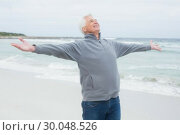 Купить «Senior man with arms outstretched at beach», фото № 30048526, снято 11 октября 2013 г. (c) Wavebreak Media / Фотобанк Лори