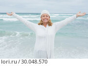 Купить «Senior woman with arms outstretched at beach», фото № 30048570, снято 11 октября 2013 г. (c) Wavebreak Media / Фотобанк Лори
