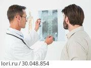 Купить «Male doctor explaining spine xray to patient», фото № 30048854, снято 16 октября 2013 г. (c) Wavebreak Media / Фотобанк Лори