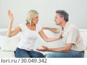 Купить «Angry woman about to slap a man at home», фото № 30049342, снято 17 октября 2013 г. (c) Wavebreak Media / Фотобанк Лори