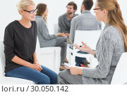 Купить «Group therapy session with therapist and client in foreground», фото № 30050142, снято 4 ноября 2013 г. (c) Wavebreak Media / Фотобанк Лори