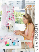 Купить «Young female fashion designer working on fabrics», фото № 30050878, снято 5 ноября 2013 г. (c) Wavebreak Media / Фотобанк Лори