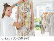 Купить «Portrait of a female fashion designer measuring model», фото № 30050970, снято 5 ноября 2013 г. (c) Wavebreak Media / Фотобанк Лори