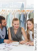 Купить «Three fashion designers discussing designs», фото № 30051022, снято 5 ноября 2013 г. (c) Wavebreak Media / Фотобанк Лори