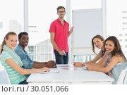 Купить «Casual business people in office at presentation», фото № 30051066, снято 5 ноября 2013 г. (c) Wavebreak Media / Фотобанк Лори