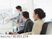 Купить «Business people in office at presentation», фото № 30051274, снято 2 ноября 2013 г. (c) Wavebreak Media / Фотобанк Лори