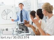 Купить «Colleagues applauding businessman after presentation», фото № 30053974, снято 3 ноября 2013 г. (c) Wavebreak Media / Фотобанк Лори