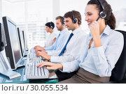 Купить «Business colleagues with headsets using computers», фото № 30055534, снято 2 ноября 2013 г. (c) Wavebreak Media / Фотобанк Лори