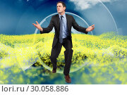 Купить «Composite image of businessman posing with arms outstretched», фото № 30058886, снято 11 декабря 2013 г. (c) Wavebreak Media / Фотобанк Лори