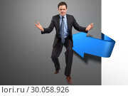 Купить «Composite image of businessman posing with arms outstretched», фото № 30058926, снято 11 декабря 2013 г. (c) Wavebreak Media / Фотобанк Лори