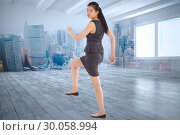 Composite image of businesswoman stepping up. Стоковое фото, агентство Wavebreak Media / Фотобанк Лори