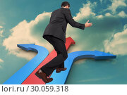 Купить «Composite image of businessman posing with arms outstretched», фото № 30059318, снято 11 декабря 2013 г. (c) Wavebreak Media / Фотобанк Лори
