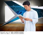 Купить «Composite image of male looking at his tablet computer», фото № 30059666, снято 10 января 2014 г. (c) Wavebreak Media / Фотобанк Лори