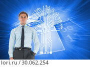 Купить «Composite image of serious businessman standing with hand in pocket», фото № 30062254, снято 11 января 2014 г. (c) Wavebreak Media / Фотобанк Лори