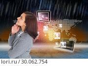 Composite image of smiling thoughtful businesswoman. Стоковое фото, агентство Wavebreak Media / Фотобанк Лори