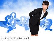 Composite image of serious businesswoman bending. Стоковое фото, агентство Wavebreak Media / Фотобанк Лори