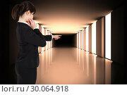 Купить «Composite image of thoughtful businesswoman pointing», фото № 30064918, снято 11 января 2014 г. (c) Wavebreak Media / Фотобанк Лори