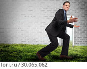 Купить «Composite image of businessman posing with arms outstretched», фото № 30065062, снято 11 января 2014 г. (c) Wavebreak Media / Фотобанк Лори