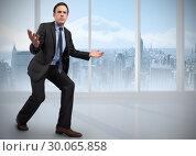 Купить «Composite image of businessman posing with arms outstretched», фото № 30065858, снято 11 января 2014 г. (c) Wavebreak Media / Фотобанк Лори